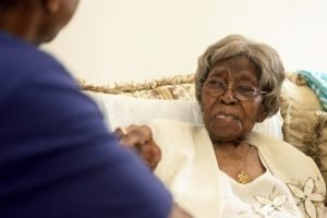 Roosevelt Patterson greeting his remarkable grandmother Hester Ford at her 111th birthday party