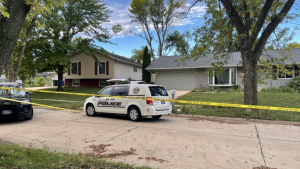 police vehicle outside taped-off home