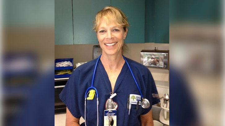 Leah Davis Lokan in her nurse's uniform