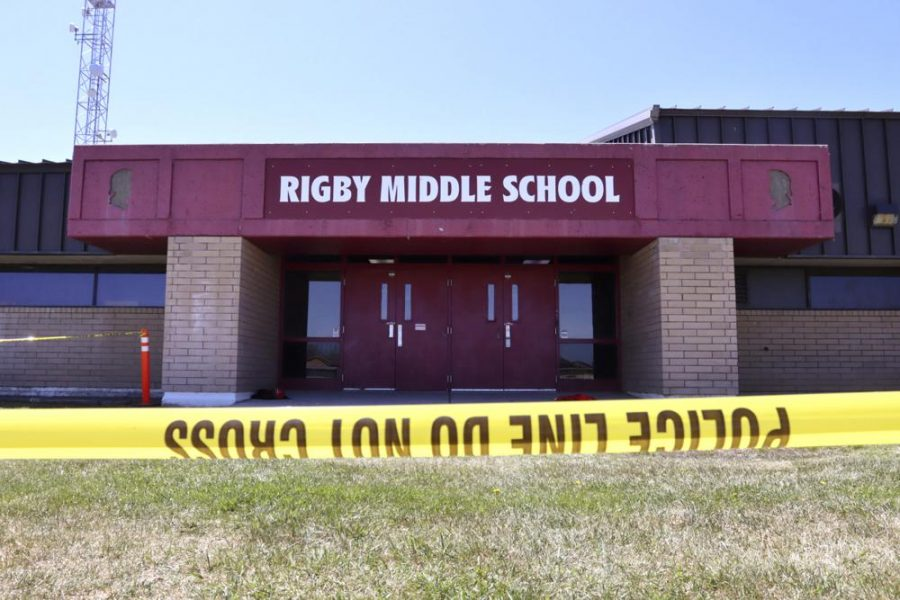 Police tape marking a line outside Rigby Middle School