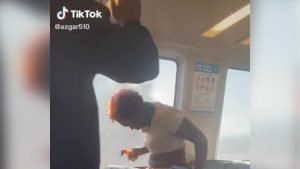 woman filmed on Bay Area commuter train with hair on fire