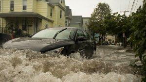 black car caught in flood