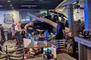 Cops assess the damage after a disgruntled patron plowed his truck through the front of a Georgia bar