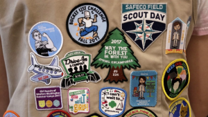 patches covering the back of a Girl Scout's vest