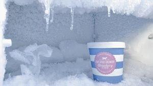 carton of strawberry ice cream in freezer