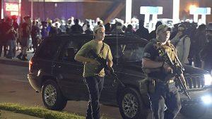 Kyle Rittenhouse walking along Sheridan Road in Kenosha, Wis., Tuesday evening with another armed civilian.