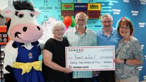 Tom Cook, Joseph Feeney and their wives receiving their Wisconsin Lottery check